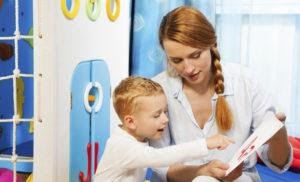 A speech and language therapist working with a young child