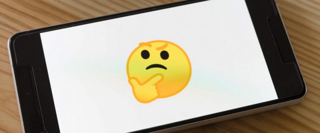 Mobile phone showing thinking emoji.
