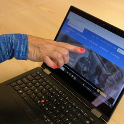 Woman pointing to Recovery College Online website on the laptop